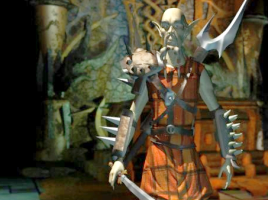 Dakkon from Planescape: Torment. A bald man with a moustache in a plaid tunic and spiky fantasy armor, with a remarkably large sword.