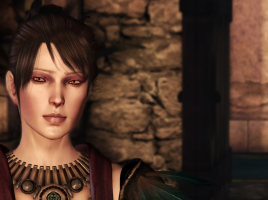 Morrigan stands in a castle room, fire-lit. There is a doorway behind her