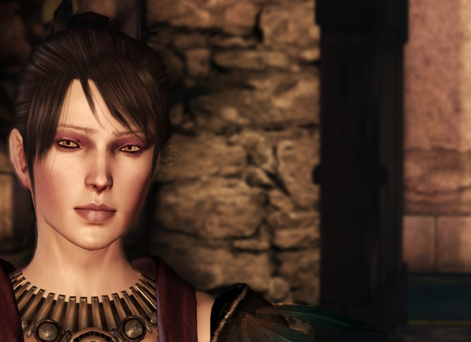 Morrigan stands in a castle room, fire-lit. There is a dark doorway behind her.