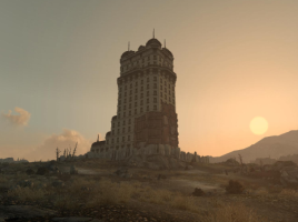 A screenshot from Fallout 3. Tenpenny Tower in the distance, with the sun setting in the background.
