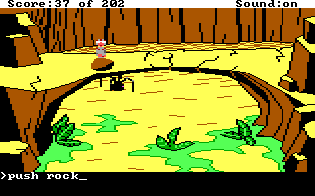 "Roger stands by a rock on a bridge. There is a large spider-thing on the ground below. Input text: ""push rock"""