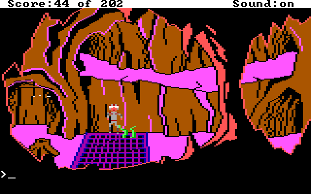 Roger in a pink cave. He is scooting carefully past a grate from which tentacles emerge.