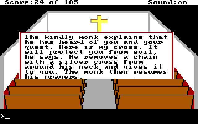 Same scene. Game text describes the monk giving Graham a cross.