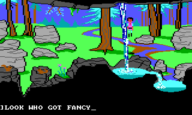 "Gwydion stands outside by a waterfall. There are lots of trees and rocks at various depths of field, and a stream runs off into the distance. The waterfall is in the extreme foreground and has a complicated blue-and-white texture. Game text reads: ""LOOK WHO GOT FANCY"""