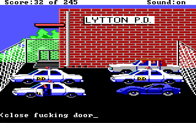 "Sonny sits in his cop car in the police station parking lot with the door open. Input text reads: ""close fucking door"""