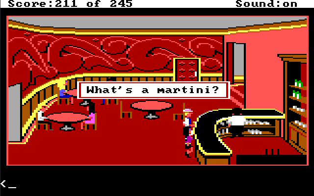"A hotel bar with red walls and carpet. There are a few pink tables and a curved black bar. Sonny stands next to the bar with blond hair, a hat, and a white suit. Marie stands next to him. There is a bartender in a white jacket behind the bar, facing away from them. Game text reads: ""What's a martini?"""