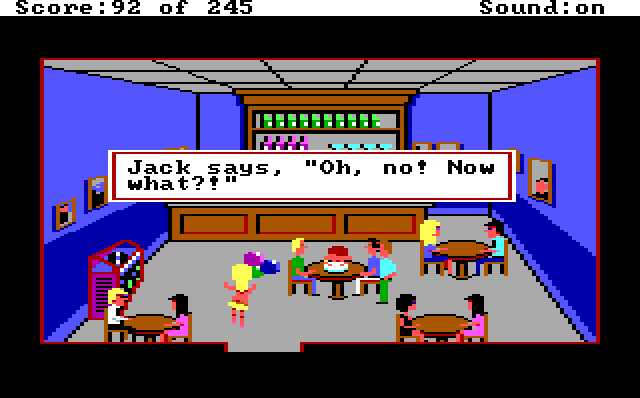 "The cops sit around a table in the bar. Jack is face down in his birthday cake. A blonde white woman in a tiny yellow bikini enters holding balloons and swinging her ass. Game text reads: ""Jack says, 'Oh no! Now what?!'"""