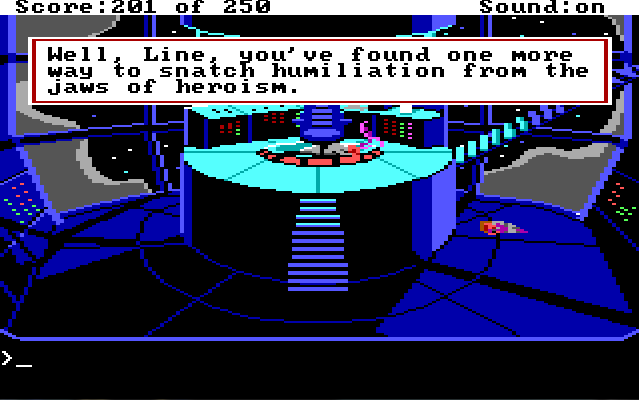 "The control room. The gray-suited man lies face down by his chair. Roger lies in a mangled heap under the staircase leading up from the platform. Game text: ""Well, Line, you've found one more way to snatch humiliation from the jaws of heroism."""