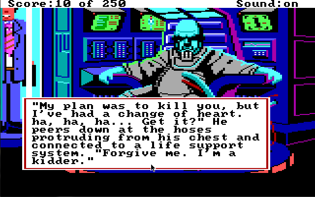 "A bald blue man in a gray space suit with some kind of breathing apparatus sits in a chair in front of a wall of screens and electronic equipment. He is scowling. A smiling man in a suit stands in a tube behind him.  Game text reads: ""'My plan was to kill you, but I've had a change of heart. ha, ha, ha... Get it?' He peers down at the hoses portruding from his chest and connected to a life support system. 'Forgive me. I'm a kidder.'"""