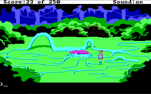 A clearing surrounded by bushes. The bush in the back is covered with red berries. In the center is a purple blob. Blue tentacles extend from it across the entire clearing, forming a narrow maze. Roger stands in the maze, wrapped up in a tentacle.
