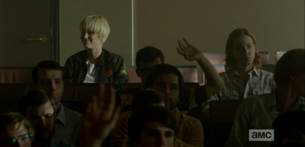 Still from Halt and Catch Fire. Same scene as previous image. A lone woman with short blonde hair sits in the back of a classroom. The students in front of her are all men.