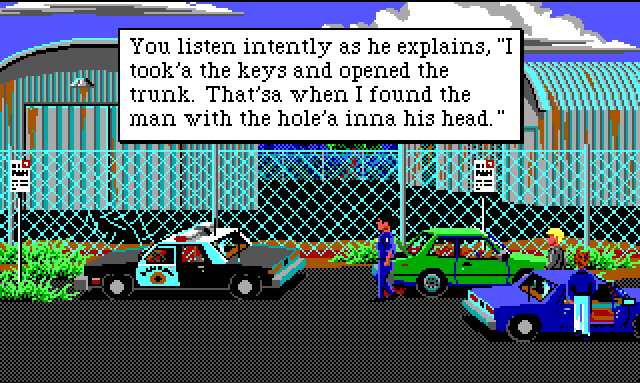 "Several cars, including a cop car, are parked by a chain link fence. There are some large rusty warehouses in the background. Sonny stands by his car. There is a dark-haired white cop nearby. Game text reads: ""You listen intently as he explains, ""I took'a the keys and opened the trunk. That'sa when I found the main with the hole'a inna his head."""