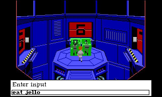 "Roger stands in a large cylindrical room with an octagonal platform in the center. On the platform are two green jello blocks with people encased in them. There are four doors entering in the chamber, but only the south door has a ramp extending to the platform. Input text reads: ""eat jello"""