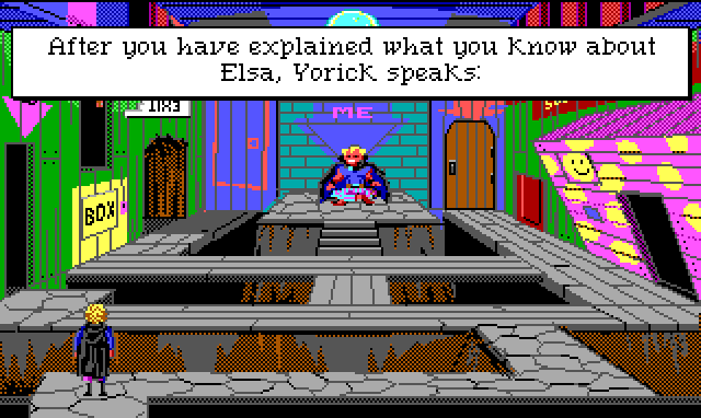 "Hamburger Tree stands in a colorful funhouse-style room. Maze-like platforms run around it, and the walls are lined with strange-looking doors and confusing signs. A wizard in a big cloak sits crosslegged in the middle platform. Game text: ""After you have explained what you know about Elsa, Yorick speaks:"""