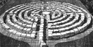 Black-and-white etching of a crumbling stone labyrinth.